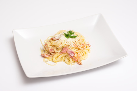 Spaghetti Carbonara Plate With Baked Ham And Parmesan photo