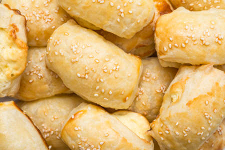 Cheese Filled Croissants With Sesame Topping Close Up photo