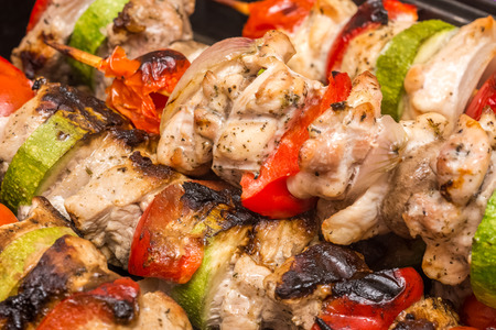chicken meat: Barbecue Shishkabob With Chicken Meat, Red Peppers, Mushrooms, Tomatoes And Zucchini Stock Photo