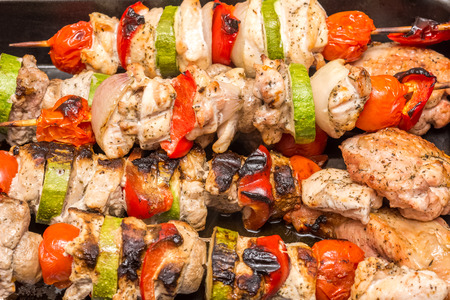 Barbecue Shishkabob With Chicken Meat, Red Peppers, Mushrooms, Tomatoes And Zucchini photo