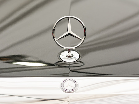 daimler: BUCHAREST, ROMANIA - APRIL 04, 2014  Mercedes Benz Sign Close Up  Founded in 1926 is a German luxury automobile manufacturer, a multinational division of the German manufacturer Daimler AG