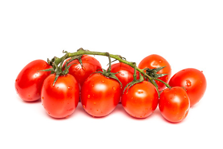 Bunch Of Fresh Wet Red Tomato Isolated On White photo