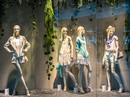 shop display: BUCHAREST, ROMANIA - APRIL 20  Boutique Fashion Mannequins In Fashion Shop Display on April 20, 2014 in Bucharest, Romania