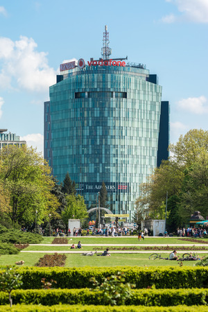 headquartered: BUCHAREST, ROMANIA - APRIL 29  Vodafone Building viewed from park Herastrau on April 29, 2014 in Bucharest, Romania  It is the second-largest mobile telecommunications company headquartered in London