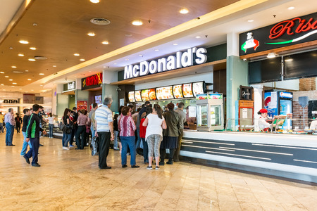 BUCHAREST, ROMANIA - APRIL 21  People buying fast-food from McDonald s Restaurant on April 21, 2014 in Bucharest, Romania  McDonald s is the main fast-food restaurant chain in Romania