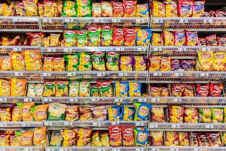 28: BUCHAREST, ROMANIA - APRIL 28  Fast Food Snacks On Supermarket Shelf on April 28, 2014 in Bucharest, Romania