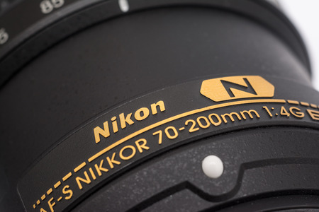 tele up: BUCHAREST, ROMANIA - MAY 12, 2014  Nikon Lens For Digital Single Lens Reflex Camera  Founded in 1917 is a Japanese multinational corporation specializing in optics and imaging products