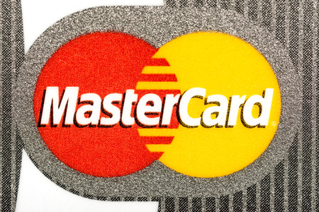 BUCHAREST, ROMANIA - MAY 15, 2014  Mastercard Credit Card Sign Close Up  Throughout the world, its principal business is to process payments between the banks of merchants and the card issuing banks
