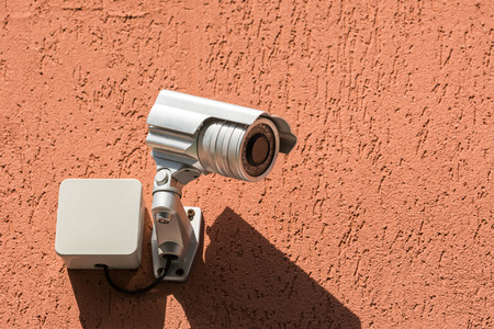 home video camera: Surveillance Security Camera On Building Wall