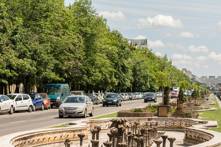 BUCHAREST, ROMANIA - MAY 13  Rush Hour Traffic On Unification Boulevard on May 13, 2014 in Bucharest, Romania  Bulevardul Unirii  Unification Boulevard  is a major thoroughfare in central Bucharest