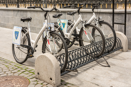 shared sharing: BUCHAREST, ROMANIA - JUNE 08, 2014  Bicycle Sharing System Downtown Bucharest  Is a service in which bicycles are made available for shared use to individuals on a very short term basis  Editorial