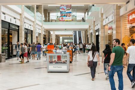 BUCHAREST, ROMANIA - JUNE 14  People Shopping In Luxurious Shopping Mall on June 14, 2014 in Bucharest, Romania