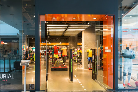 world   s largest: BUCHAREST, ROMANIA - JUNE 14  Nike store on June 14, 2014 in Bucharest, Romania  It is one of the world s largest suppliers of athletic shoes and apparel and a major manufacturer of sports equipment  Editorial