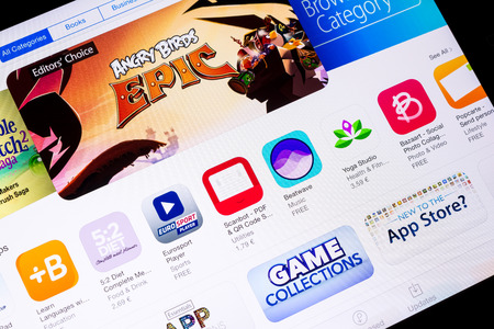 app store: BUCHAREST, ROMANIA - JUNE 16, 2014  Apple Application Store On Apple iPad Air  In 2008, Apple launched the App Store introducing third-party app development and distribution