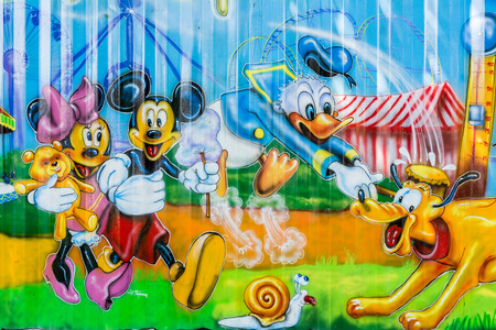 BUCHAREST, ROMANIA - JUNE 08, 2014  Disney Cartoon Characters In Youths Public Amusement Park  Tineretului Park  On Summer Day  Created in 1965 is one of the largest fun parks in south Bucharest