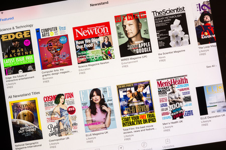 BUCHAREST, ROMANIA - JUNE 19, 2014  Apple Newsstand Store On Apple iPad Tablet  Is an application on iOS and is dedicated to downloading and displaying digital versions of newspapers and magazines