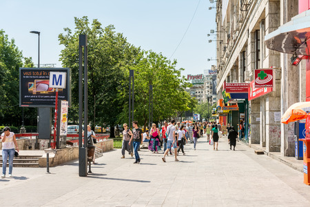 BUCHAREST, ROMANIA - JUNE 09, 2014 Crowd Of Busy People Going\ To Work In Piata Unirii Unification Square Of Bucharest It is one\ of the largest squares in central Bucharest\