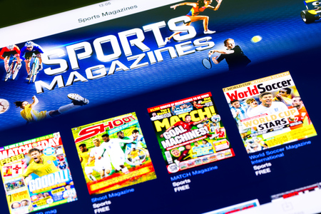 BUCHAREST, ROMANIA - JUNE 21, 2014  Sports Magazines In Apple Application Store On Apple iPad Tablet