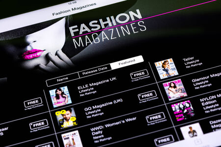 BUCHAREST, ROMANIA - JUNE 21, 2014  Fashion Magazines In Apple Application Store On Apple iPad Tablet