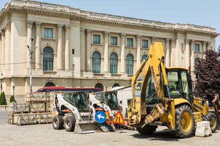BUCHAREST, ROMANIA - JUNE 09, 2014  Construction Vehicles Restyle Victory Street  Calea Victoriei  Of Bucharest  From 1692 Calea Victoriei  Victory Avenue  is a major avenue in central Bucharest