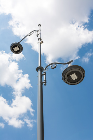 Street Light Pole Against Blue Sky photo