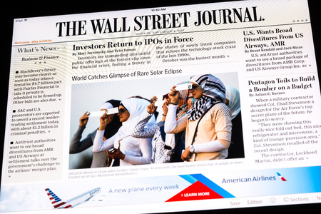 BUCHAREST, ROMANIA - NOVEMBER 04, 2013  The Wall Street Journal Newspaper On Apple iPad Tablet  Is an American international daily newspaper with a special emphasis on business and economic news