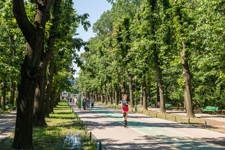 BUCHAREST, ROMANIA - JUNE 29, 2014  People Walking In Herastrau Park On Summer Day  Opened in 1939 it is the largest park of the city and is located on the northern side of Bucharest