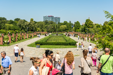 BUCHAREST, ROMANIA - JUNE 29, 2014  People Taking A Walk On Summer Day In Herastrau Public Park  Opened in 1939 it is the largest park of the city and is located on the northern side of Bucharest