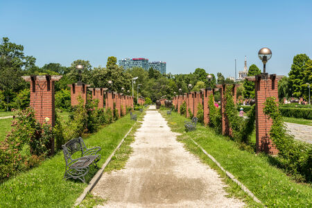 BUCHAREST, ROMANIA - JUNE 29, 2014  Alley Way In Herastrau Public Park  Opened in 1939 it is the largest park of the city and is located on the northern side of Bucharest