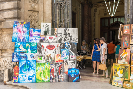 BUCHAREST, ROMANIA - JUNE 29, 2014  Outside Art Gallery Paintings Exposed On Lipscani Street In Downtown Bucharest