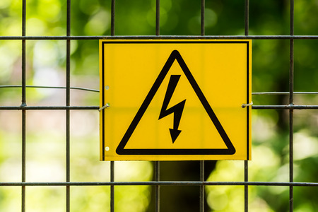 electric fence: Danger High Voltage Electric Fence Warning Sign Stock Photo