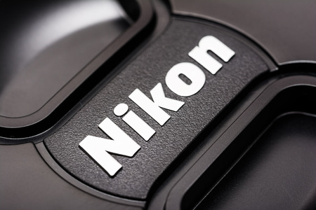 headquartered: BUCHAREST, ROMANIA - JULY 05, 2014  Nikon Sign On Dslr Lens  It is a Japanese multinational corporation headquartered in Tokyo, Japan, specializing in optics and imaging products