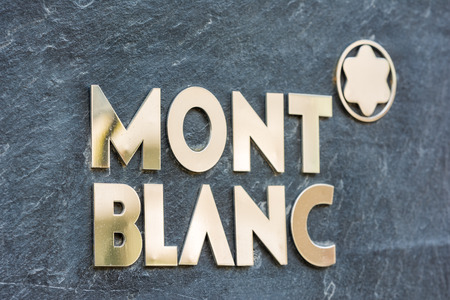 identified: BUCHAREST, ROMANIA - JULY 06, 2014  Mont Blanc Sign  Founded in 1906 it is a German manufacturer of writing instruments, watches, jewellery and leather goods often identified by their  White Star   Editorial