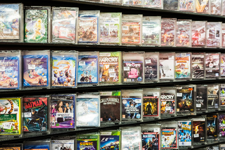 BUCHAREST, ROMANIA - JULY 08, 2014  DVD Stand With Music, Movies And Games Dvd s On Supermarket Shelf On July 08, 2014 In Bucharest, Romania