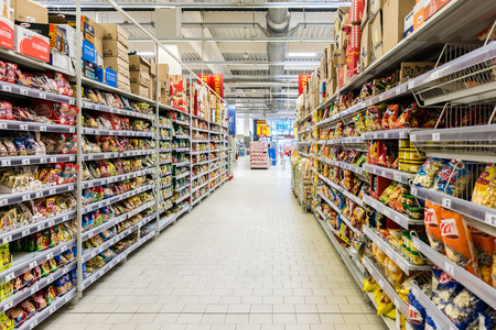 BUCHAREST, ROMANIA - JULY 09, 2014  Junk Food For Sale In Supermarket Aisle
