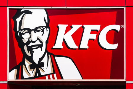 headquartered: BUCHAREST, ROMANIA - JULY 10, 2014  Kentucky Fried Chicken Restaurant Sign  It is a fast food restaurant chain headquartered in United States specialized in chicken products