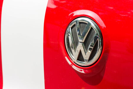 headquartered: BUCHAREST, ROMANIA - JULY 10, 2014  Volkswagen Sign  Founded in 1937 is a German automobile manufacturer headquartered in Wolfsburg, Germany and means  people s car  in german language  Editorial