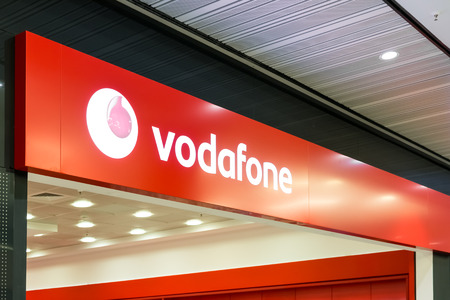 headquartered: BUCHAREST, ROMANIA - JULY 18, 2014  Vodafone Store Sign  It is the world s second-largest mobile telecommunications company headquartered in London