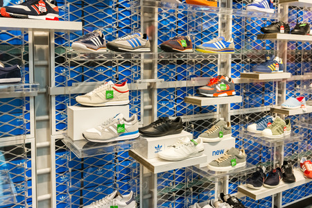 adidas: BUCHAREST, ROMANIA - JULY 18, 2014  Adidas Shoes In Shoe Store Display  Is a German multinational corporation that designs and manufactures sports clothing and accessories based in Germany
