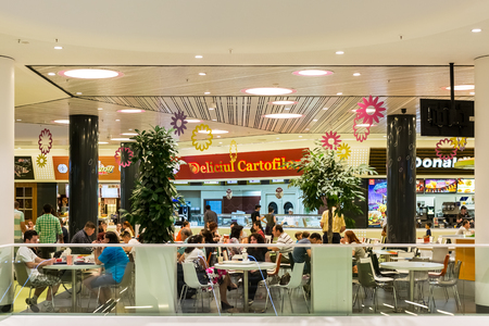 BUCHAREST, ROMANIA - JULY 19, 2014  People Crowd Eating Fast Food On Restaurant Floor In Luxurious Shopping Mall