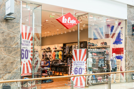 denim jeans: BUCHAREST, ROMANIA - JULY 22, 2014  People Buying Clothes In Lee Cooper Store  Lee Cooper is a British clothing company that licenses the sale of many branded items, including denim jeans