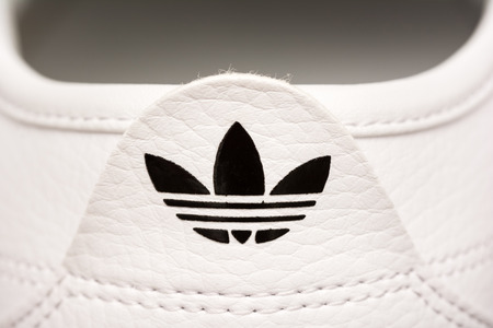 adidas: BUCHAREST, ROMANIA - JULY 23, 2014  Adidas Sign On Adidas Sport Shoes  Founded in 1924 is a German multinational corporation that designs and manufactures sports shoes, clothing and accessories