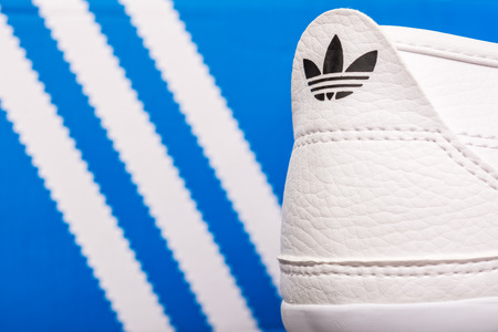 adidas: BUCHAREST, ROMANIA - JULY 23, 2014  Adidas Sport Shoes Close Up  Founded in 1924 is a German multinational corporation that designs and manufactures sports shoes, clothing and accessories