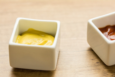 Mustard And Ketchup Sauce In White Bowl photo