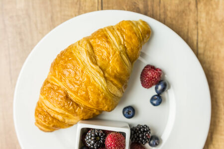 Croissant And Fresh Fruits Breakfast photo