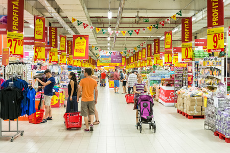 BUCHAREST, ROMANIA - AUGUST 10, 2014  People Shopping In Supermarket Store Aisle