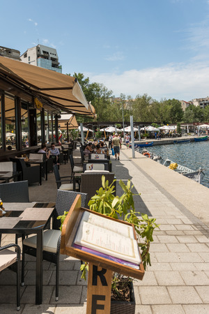 people eating: CONSTANTA, ROMANIA - JULY 29, 2014: People Eating At Fancy Restaurants In Constanta Promenade At The Black Sea.