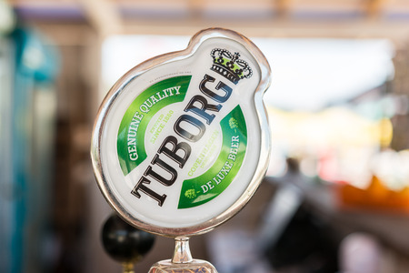 carl: BUCHAREST, ROMANIA - AUGUST 01, 2014: Tuborg Sign On Beer Dispenser. It is a Danish brewing company founded in 1873 by Carl Frederik Tietgen and sells a variety of beers in over 31 countries.