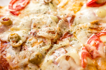 Home Made Pizza With Mushrooms, Tomatoes And Mozzarella Close Up photo