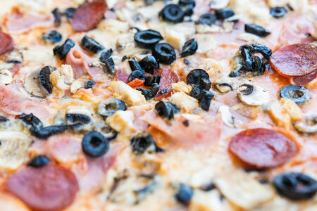 Pepperoni Pizza Close Up With Mushrooms, Olives And Chili Salami photo